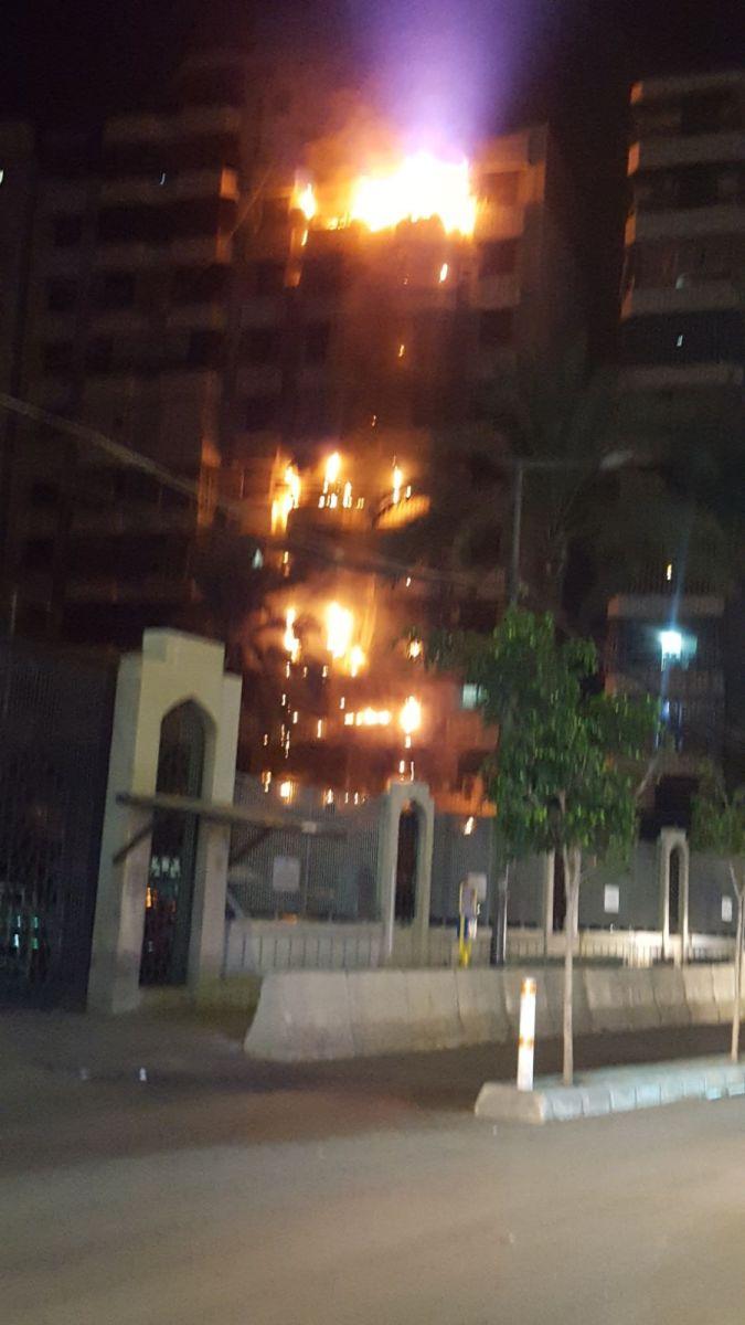 عاجل : بالصور: حريق في بناية قرب مجمع سيد الشهداء في الرويس